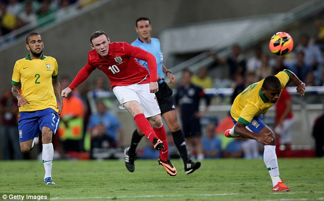 Wonder goal: Rooney smashed home England's second goal of the night against Brazil at the Maracana