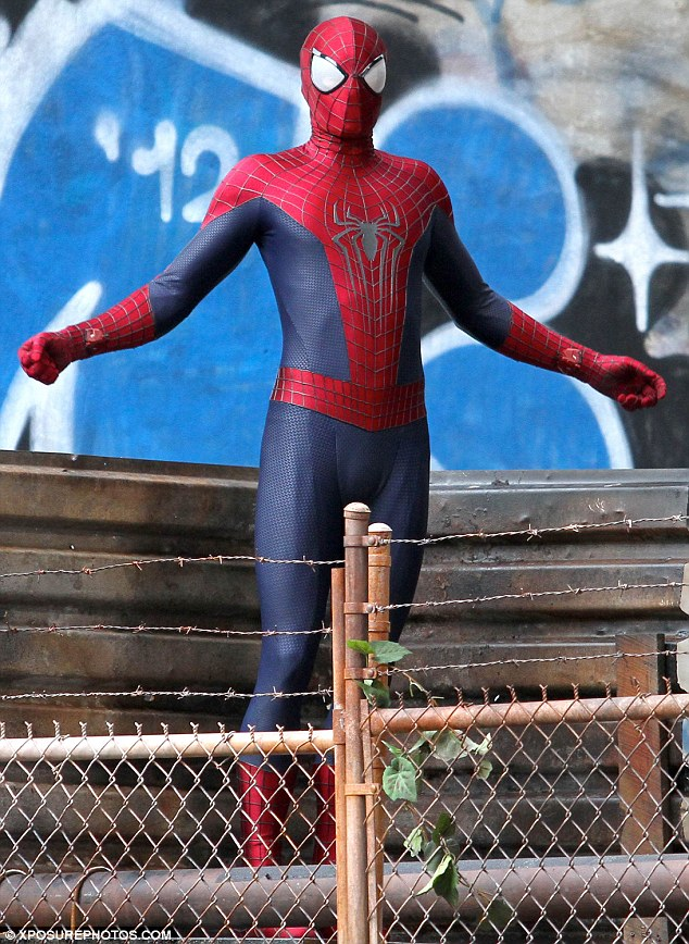 Spidey power: Spider-Man strikes a pose during filming