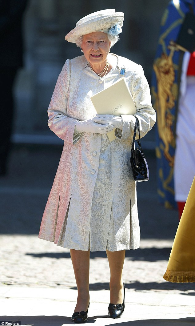 Seeing blue: Queen Elizabeth leaves Westminster Abbey after celebrating the 60th anniversary of her coronation in a light blue ensemble
