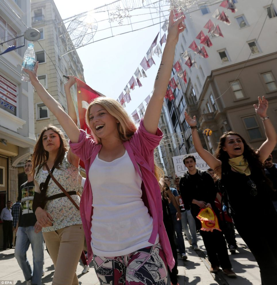 Determined: Women shout slogans against the government on a bright sunny day in Istanbul yesterday