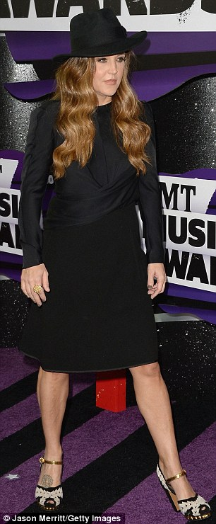 Why so serious? Lisa Marie Presley looked somber in a black hat and dress at the Country Music Television Awards on Wednesday in Nashville, Tennessee