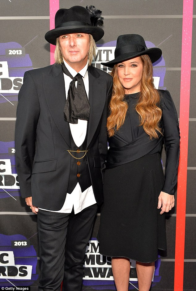 Matchy matchy: Lisa Marie's husband Michael Lockwood also opted for a black hat and a father in his cap