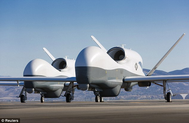 Deadly machines: Two Northrop Grumman MQ-4C Triton unmanned aerial vehicles are seen on the tarmac at a Northrop Grumman test facility in Palmdale, California