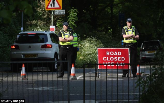Ring of steel: Police officers man a road block as delegates arrived for the four-day meeting