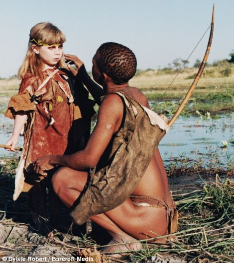 Medical help: Tkui applying medicine made from berries to Tippi's eye in Namibia