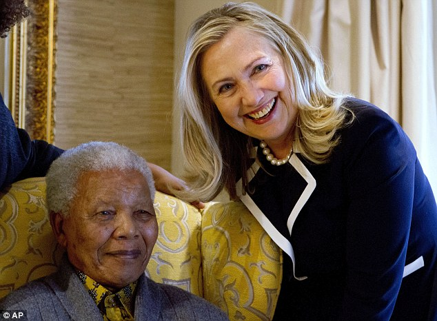 'Beloved statesman': Hilary Clinton, then U.S. Secretary of State, is seen meeting with Mr Mandela at his South African home in August 2012
