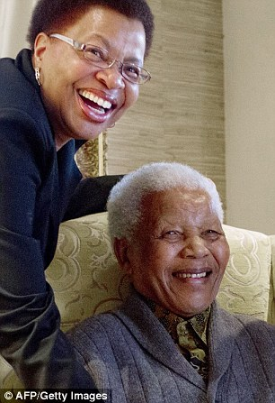 'Fighter': Nelson Mandela and his wife Graca Machel smile for the camera at their home in Qunu, South Africa, in August 2012 during an increasingly rare public appearance