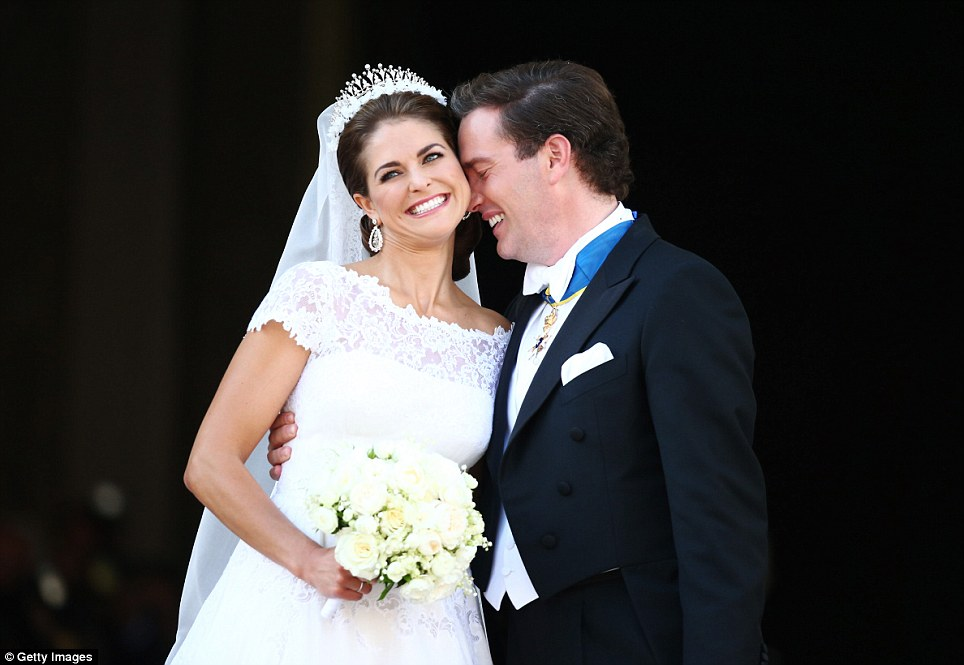 Newlyweds: Princess Madeleine and her new husband Chris O'Neill looked the picture of happiness as they appeared on the balcony at the Royal Palace following today's ceremony