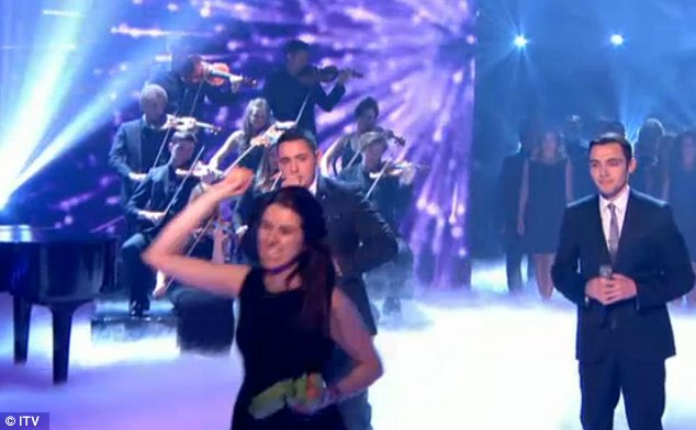 Stage invasion: A woman ran up in front of the judges to pelt them with eggs