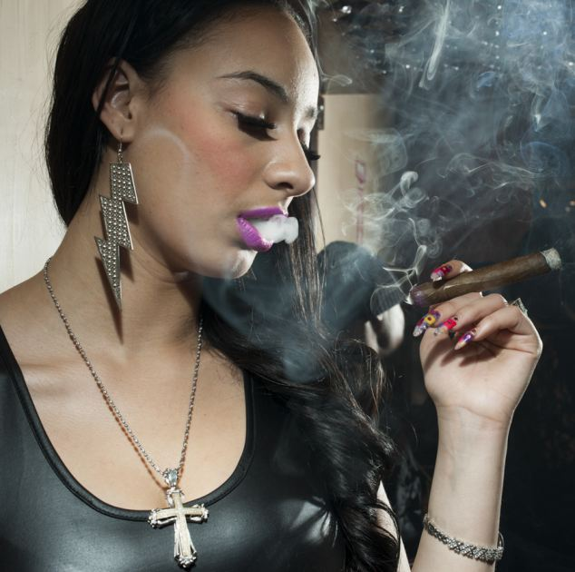 Blinging: A 'hip-hop honey' clutches a cigar during the filming of a music video