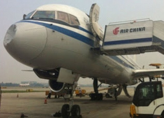 Pictures of the Air China jet show the damage the mysterious mid-air collision caused to its nose cone after