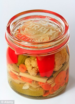 Non-pasteurised pickled vegetables - and the fibre in them - feeds our guts' microbial residentsAWPPGG Jar of mixed pickles in a