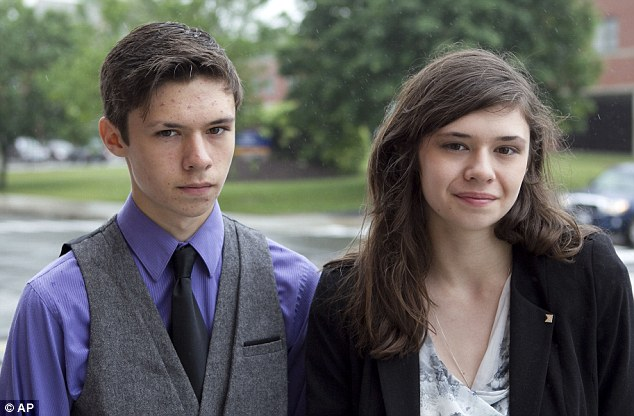 Identical twins: Jonas Maines, left, and his transgender sister, Nicole Maines, stand outside the Penobscot Judicial Center in Bangor, Maine