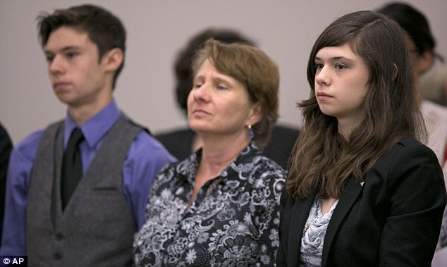 Fighting in human rights case: Nicole Maines, right, stands with her brother Jonas Maines, and her mother, Kelly Maines, during a hearing before the Maine Supreme Court after she was made to use staff bathrooms at school
