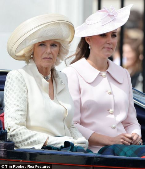 All wrapped up: Camilla the Duchess of Cornwall and Catherine the Duchess of Cambridge made sure they had a blanket to cover their knees in case the weather turned chilly