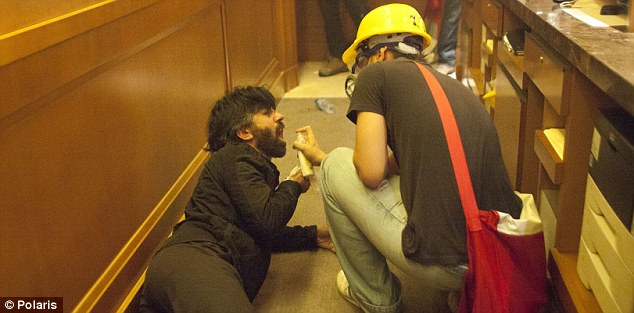 Treated: A medic looks after one of the injured at the hotel after the eviction of protesters from Taksim Square and Gezi Park