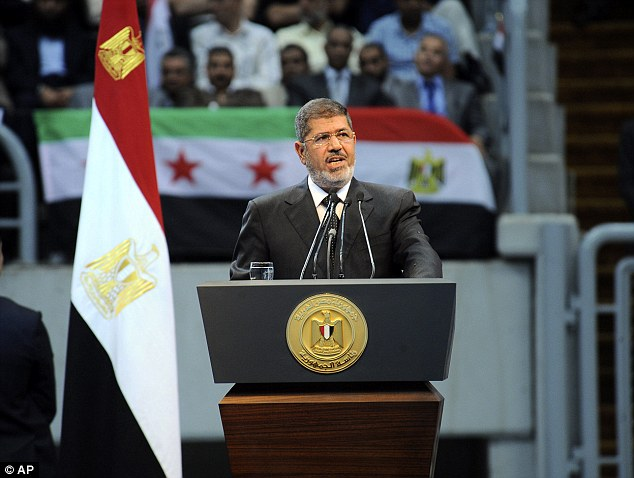 Egyptian President Mohammed Morsi yesterday announced that he was cutting off diplomatic relations with Syria and closing Damascus' embassy in Cairo amid growing calls from hard-line Sunni clerics to launch a 'holy war' against Syria's embattled regime