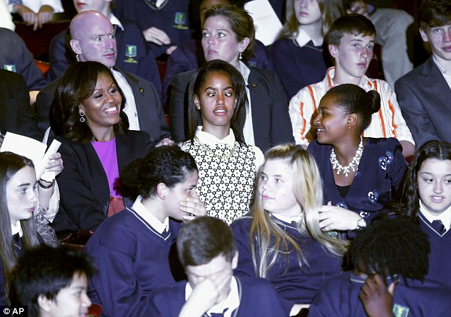 All laughs: Malia Obama makes her mother and sister laugh ahead of a special performance of Riverdance in Dublin