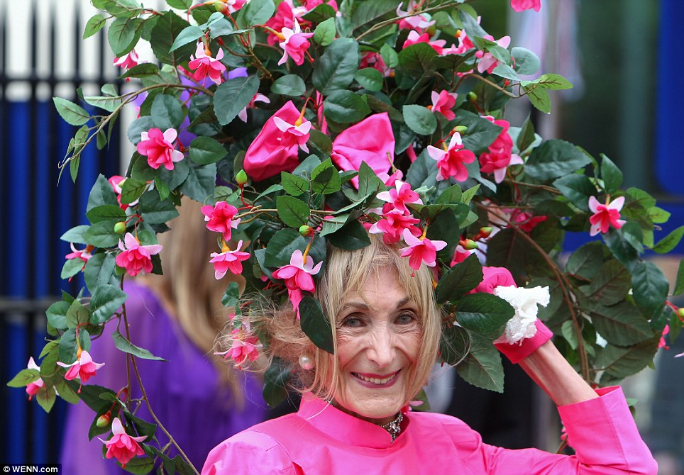 Blooming marvellous: Race goer Florence Claridge from Dover looked radiant in a gigantic hat inspired by beautiful fuchsia bushes