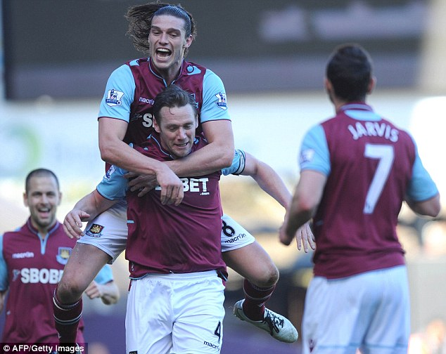 Happy days: Carroll, despite injuries, enjoyed a successful first season at West Ham