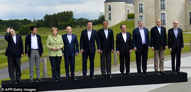 Smile!: Leaders pose at the G8 summit, which officially has been the greatest diplomatic shindig in the world. But unofficially, it was more like stewpot of downright loathing