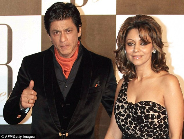 Controversy: Bollywood superstar Shah Rukh Khan, left, and his wife Gauri, right, are facing an investigation by health officials in India folowing reports that the couple know the sex of a baby they are having through a surrogate mother