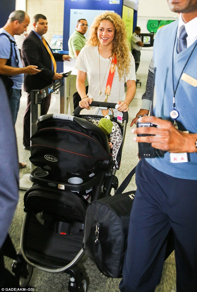 A Glowing Shakira Cradles Son Milan As She Jets Into