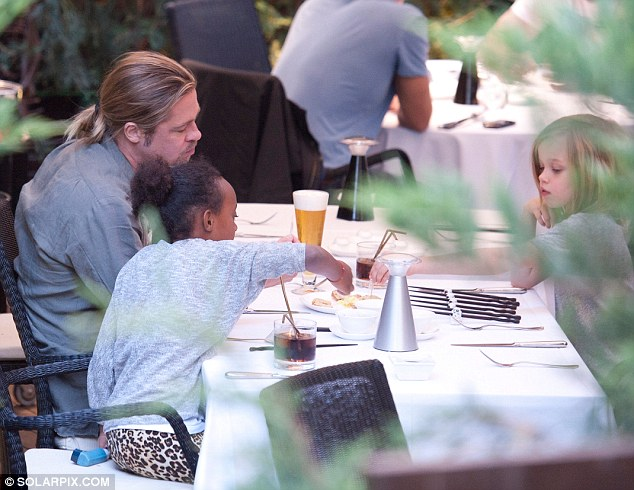 His lil' leading ladies: Brad Pitt made time for an intimate Japanese meal with his daughters Zahara and Shiloh in Madrid on Friday