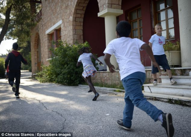 Nine-year-old Nicholas with the other children running to the backyard of the orphanage