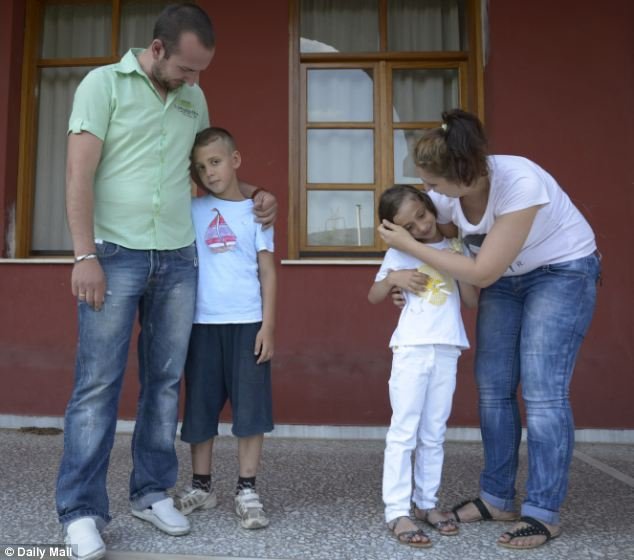 Alexandros and Olga Eleftheriadou visiting their children Nicholas and Victoria at the Zanneio Child Care Institution
