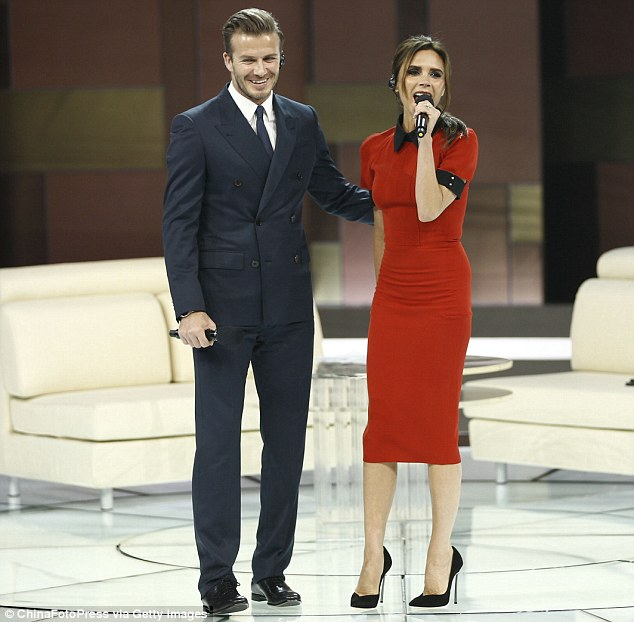 Glamorous couple: David Beckham and Victoria made for an eye-catching couple in their smart outfits