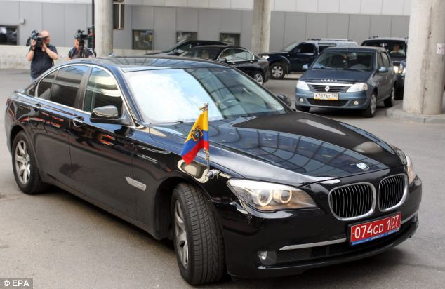 Asylum: The pair were met by two cars, pictured, from the Ecuadorian embassy parked at Moscow's Sheremetevo airport today