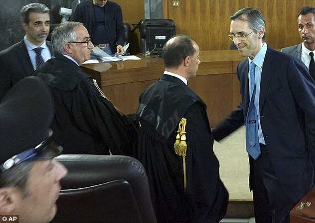 Milan's chief prosecutor Edmondo Bruti Liberati, left, shakes hand with with Silvio Berlusconi lawyer Niccolo' Ghedini who described the sentence as unjust