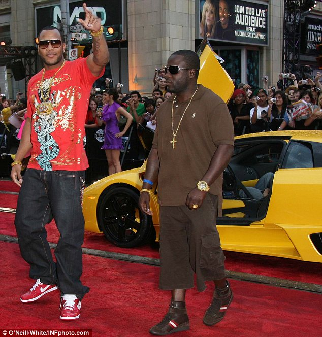 Boys and their toys: Flo Rida, pictured arriving at the 2008 MuchMusic Video Awards, loves his fast cars