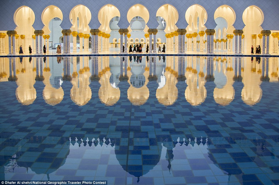 SHEIKH ZAYED MOSQUE: A reflection of the Sheikh Zayed Grand Mosque in the basin of the fountain opposite the mosque where the main dome of the mosque appears