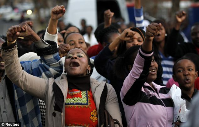 Well wishers gathered outside the hospital to sing in tribute to South Africa's first black president