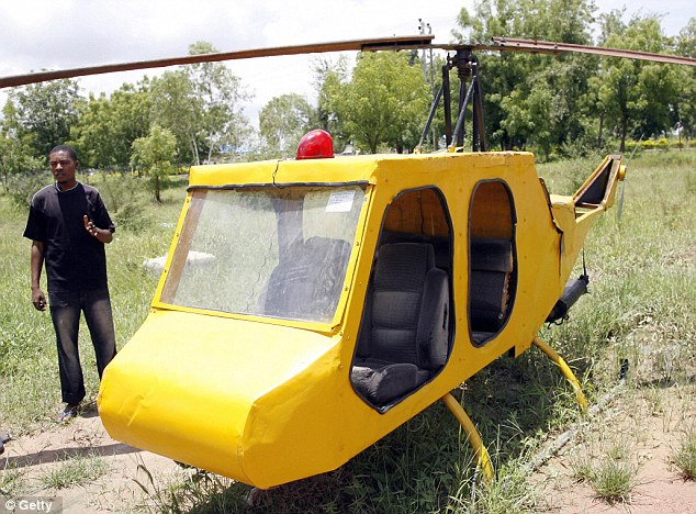 Handmade: Mubarak Abdullahi, 24, stands next to the helicopter he constructed in Kano in 2007