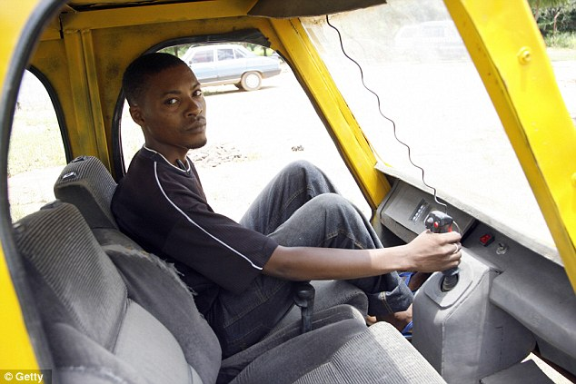 Innovation: It may look like a car, but Abdullahi, pictured sitting in the front seat, used old car parts to make his own helicopter