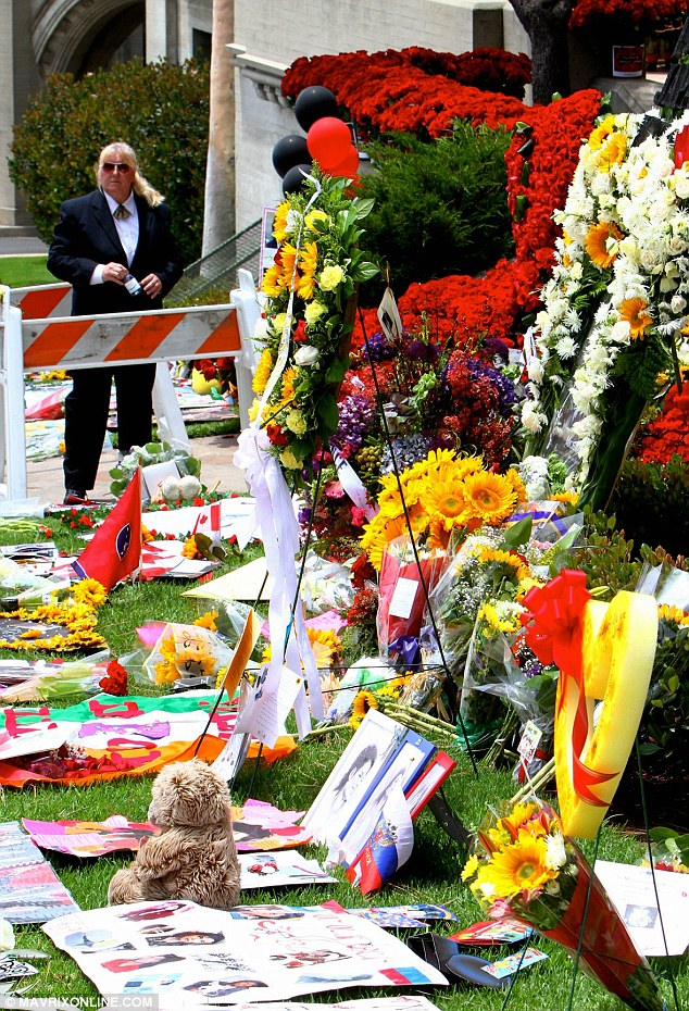 Big gesture: One fan group - called One Rose for Michael Jackson - donated more than 10,000 roses to the gravesite, it was reported