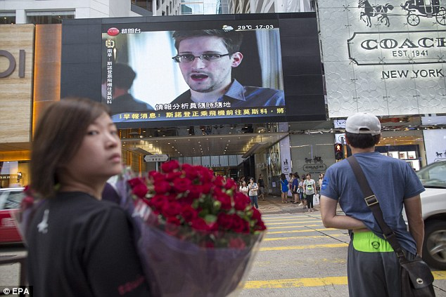 U.S. whistle-blower Edward Snowden is displayed on a giant screen in Hong Kong, China - it is believed he sent secret files to a number of individuals from the state before revelations were made public in The Guardian newspaper earlier in June