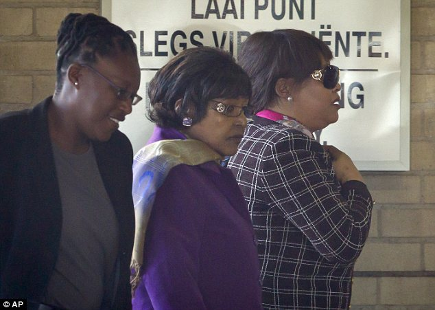 Visit: Mr Mandela's ex-wife Winnie, centre, and daughter Zindzi, right, arrive at the hospital
