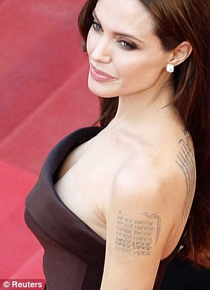 Works of art? Angelina Jolie, left, has a number of tattoos while model of the moment Cara Delevingne has one on her finger