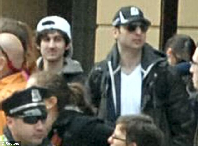 'Killers': The Tsarnaev brothers are pictured at the Boston Marathon before the bombings