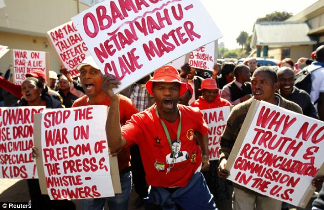 People protesting against Obama's visit to South Africa carried placards in Pretoria today