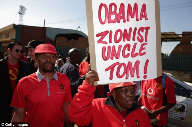 One placard accused Obama of being a 'Zionist Uncle Tom'