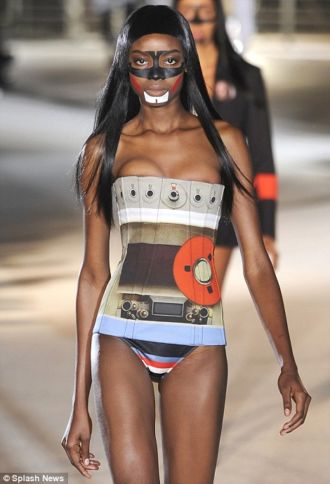 Swimsuits and corsets featured for women at the Givenchy show on Friday