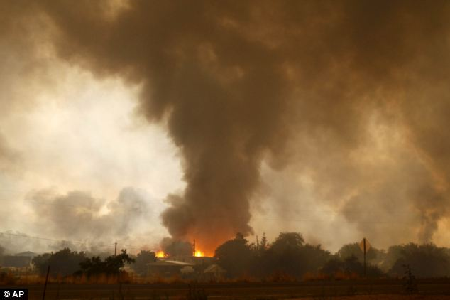 Fast-moving: The fire started with a lightning strike on Friday and spread to 2,000 acres on Sunday