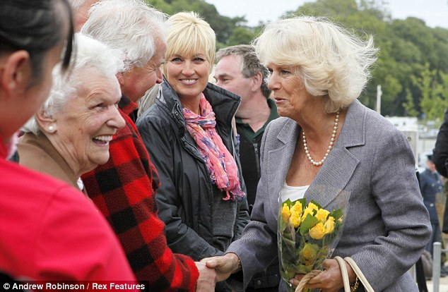 Jolly: The Royal couple met local people and farm workers during their visit to the organic Rhug Estate