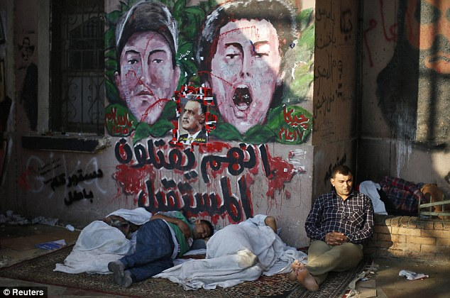 Dawn: Protesters opposing Egyptian President Mohamed Mursi sleep on the ground during a sit-in protest demanding that Mursi resign at Tahrir Square which entered its first day this morning