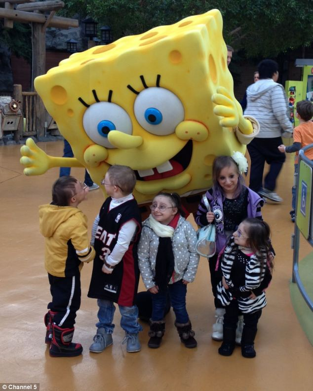 Nick and his primordial dwarf friends pose with SpongeBob SquarePants at the Mall Of America in Bloomington, Minnesota